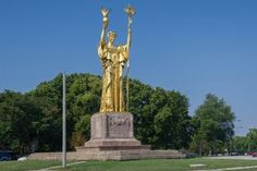 """The Statue of the Republic. The Statue of the Republic, aka the """"Golden Lady,"""" is a one-third scale replica of a sculpture by Daniel Chester French that stood in front of the Court of Honor at the 1893 World's Columbian Exposition. The 24-foot statue today stands in Chicago's Jackson Park."""