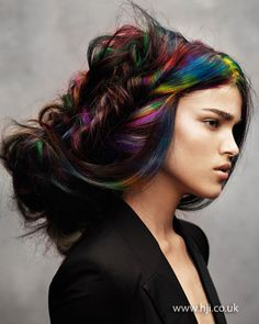 Angelo Seminara rainbow fishtail plait    How to get the look    Long black hair with rainbow-hued sections was prepped with volumising mousse and blow-dried using a round brush to achieve volume and body throughout. Once dry, hair was plaited together in random sections to create a loose chignon.