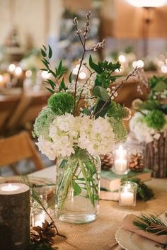 hydrangea and greenery centerpiece - photo by Allie Siarto Photography http://ruffledblog.com/woodland-michigan-barn-wedding