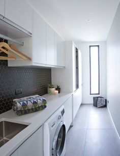 These large floor tiles are the piece-de-resistance of this stylish laundry . Modern Laundry Rooms, Laundry In Bathroom, Large Floor Tiles, Grey Floor Tiles, Black Tiles, Laundry Room Inspiration, Inside Home, Laundry Room Organization, Laundry Storage