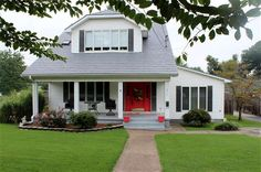 LOVE this. White house, black shutters with red door