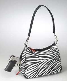 "Forget ""Ladies Home Journal"": This zebra-print hobo bag with room to hide a concealed weapon will teach men to never underestimate the power of a woman!"