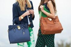 MK bags.look at these two girls,wearing MK bags,which shows their good tastes as well as their forever friendship.