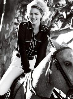 An accomplished equestrian, Upton wears a Stella McCartney midnight-blue button-down shirt, Hermès white breeches, and a Michael Kors belt.
