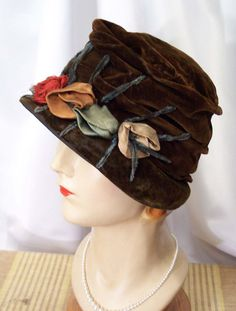 1920s brown silk velvet cloche hat with silk flowers and chenille stems.