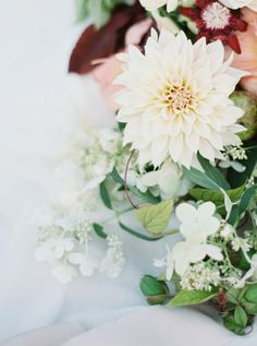 Mixed dahlia floral centerpiece: http://www.stylemepretty.com/2015/09/16/ethereal-dunes-wedding-inspiration/ | Photography: Kyle John Photo - http://www.kylejohnphoto.com/