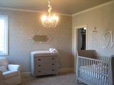 I have one other daughter who has a pink, cream, & brown room. I wanted something totally different in this baby girl's room. It started with the gray (Annapolis gray to be specific) walls & went from there. Only 1 wall is stenciled. The others were left in plain gray paint.