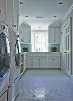 Blue and white Laundry Rooms. Blue and white laundry room features white cabinets paired with white marble countertops and blue glass subway tiled backsplash, White cabinets are suspended over whit… Bathroom Wall Cabinets, Laundry Room Cabinets, Laundry Cupboard, Basement Laundry, White Laundry Rooms, Laundry Room Inspiration, Traditional Interior, Laundry Room Design, Luxury Interior Design