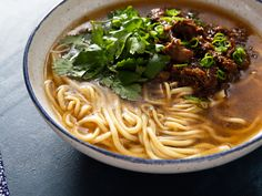Aromatic lamb soup with a spicy, tingly shredded lamb topping, perfect for serving with hand-pulled noodles.