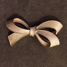 """Vintage bow brooch Approx 1.5"""" wide, gold with light white accents, very good condition Vintage Jewelry Brooches"""