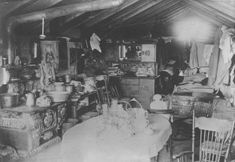 Mead family dugout near Bloom in Ford County, Kansas.  This photograph shows the interior of the L. A. Mead family dugout near Bloom, Ford County, clearly illustrating the cramped living conditions that the family endured during their stay in this residence.  Date: Between 1870 and 1890