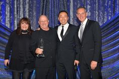 "MAY 14, 2015 (L-R) BMI Vice President of Film and Television Relations Doreen Ringer-Ross, composer Mike Post, Assistant Vice President of Film and Television Relations at BMI Ray Yee and BMI President and CEO Mike O'Neill pose with the BMI Film Music Award for ""Law & Order: SVU"" onstage during the 2015 BMI Film & Television Awards at the Beverly Wilshire Hotel on May 13, 2015 in Beverly Hills, California. (Photo by Lester Cohen/Getty Images for BMI)"