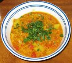 Lentil Soup (Dal) is commonly served with rice garnished with lemon juice and coriander. It is one of the main components of Nepal's national food, Dal Bhat. (Nepali Food Recipe)