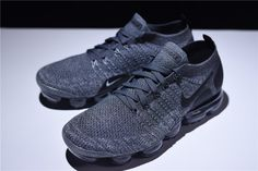 Nike Air VaporMax Flyknit 2.0 Dark Grey Mens and Womens Running Shoe 942842-002  Nikes Air VaporMax has quickly become a favorite for sneakerheads and fashion lovers alike because of its sleek design, and now the silhouette is back in a brand-new iteration. This Nike Air VaporMax features a Dark Grey and Wolf Grey Flyknit upper paired with Black detailing the Nike Swoosh logo and heel counter for a monochromatic look. A clear VaporMax sole unit completes the design. Air Max 90, Nike Air Max, New Nike Shoes, Nike Shoes Outfits, Air Jordan, Nike Swoosh Logo, Shoes With Jeans, Running Women, All Black Sneakers