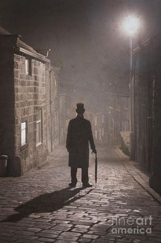 Victorian Man With Top Hat On A Cobbled Street At Night In Fog by ...