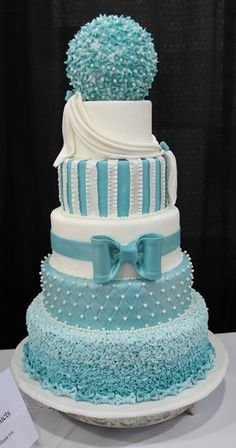Love the different design on each layer. This color is only acceptable for a baby shower though.