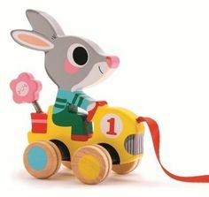 Djeco / Roulapic Wooden Rabbit Racer Pull Toy by Djeco. $18.26. Vroom-vroom - let the race begin! Mr. Rabbit has both hands on the wheel and he's ready to follow the leader wherever he or she wants to roam! This beautifully designed wooden pull toy is an updated classic that your child will play with again and again.Because play is essential to a child's development, Djeco creates toy collections that are always entertaining, educational and imaginative. Staying faithful to th...