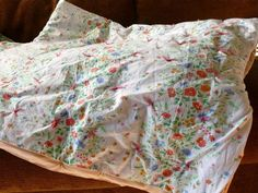 One trip to the thrift store should yield all the supplies you need to make a warm quilt: two pretty sheets and a blanket. And the making couldn't be easier.