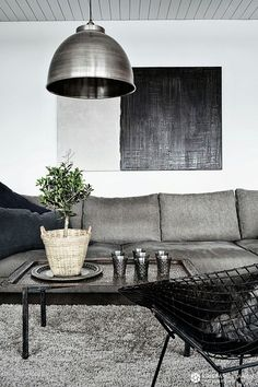 Gray living room-For more information on creating your dream home contact www.customhomesby...