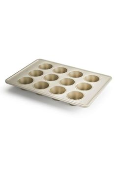 Our 12 Cup Muffin Pan is perfectly sized for muffins, cupcakes and mini quiches. Like all of our Non-Stick Pro metal bakeware, it's made with a ceramic-reinforced, two-layer, commercial-grade coating that provides ultimate non-stick release and is scratch-, stain-, corrosion- and abrasion-resistant. Unique micro-textured pattern ensures even baking.   Muffin Pan by OXO. Home & Gifts - Home Decor - Dining - Kitchen Tools Wisconsin