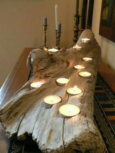 8 Easy DIY Wood Candle Holders for Some Rustic Warmth This Fall - Candles - Ideas of Candles - Driftwood comes in all sorts of interesting shapes and sizes which you can take advantage of by drilling tea light pockets into different levels of the wood. Driftwood Candle Holders, Rustic Candle Holders, Rustic Candles, Diy Candles, Driftwood Centerpiece, Rustic Wood, Rustic Decor, Candle Decorations, Beach Decorations