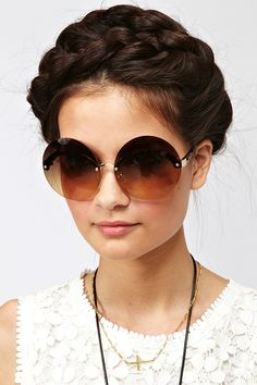 Monobrow Shades and milkmaid-style hair