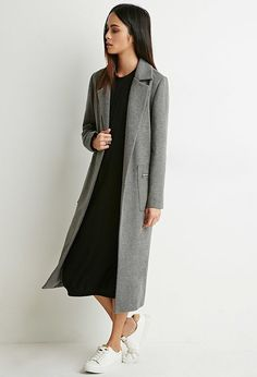 Bow down to the all-star of coats, a longline coat also known as a duster coat. Call it what you want, but ...