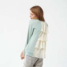 alteración del suéter de la blusa