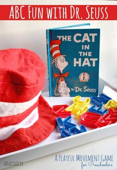 ABC Game for inspired by The Cat in the Hat by Dr. Seuss. A fun idea for learning about the alphabet with kids and these popular books by Dr. Seuss.