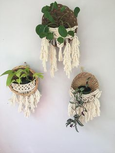 MODERN MACRAME HANGING PLANT BASKETS WITH FEATHERS Unfettered Co specializes in handmade modern fibre art and bohemian macrame statement pieces designed to fill your home with warmth, texture, whimsy, and dimension. DESCRIPTION: This listing is for the three (3) hanging macrame planter