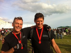 Jim Hudson and Christian Sumner celebrating at the end of their London to Brighton charity bike ride.