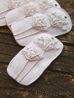 Rustically textured pendants made from the impression of a real wild growing Queen Annes Lace flower. Perfect to add a touch of countryside