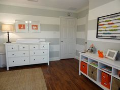 Gray striped nursery with orange accents