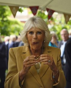 Camilla, Duchess of Cornwall tries produce during a reception to celebrate the 21st anniversary of Duchy originals products at Clarence House on 11 Sep 2013 in London, England.