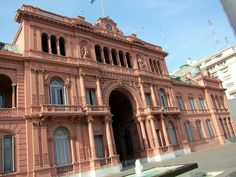 La Casa Rosada (The Pink House), officially known as Casa de Gobierno, is the official executive mansion and office of the Presidente de la Nación Argentina (President of the Argentine Nation). Its balcony, which faces this large square, has famously served as a podium by many figures, including Eva Perón, who rallied the descamisados there, and Pope John Paul II, who visited Buenos Aires in 1998.