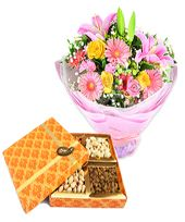 Midnight Power Seasonal Flowers Bouquet with Assorted Dry Fruits containing cashew nuts, almonds, apricots and raisins (gross weight 500 gms)