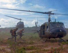 Huey helicopters u.s. military army vietnam war photo m-16 veterans ho chi minh