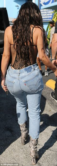 Racy in lace: Kim Kardashian wore a bustier and high-waisted jeans while in Miami on Thursday