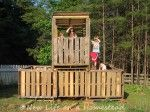 Sneak Peak At The Pallet Fort- kids fort or playhouse made out of pallets and scrap wood. For free!