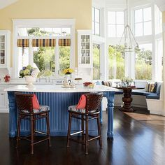 Bay windows are a perfect place for a built-in banquette! More remodeled kitchens: http://www.bhg.com/kitchen/remodeling/planning/kitchen-remodeling-costs-eat-in-kitchen/?socsrc=bhgpin022213baywindows=8