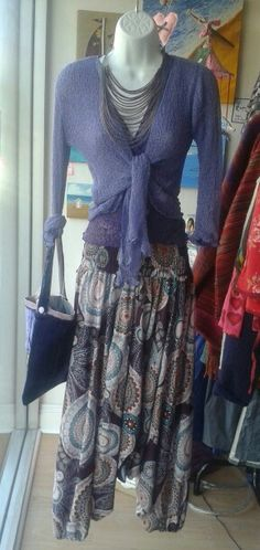 Autmnal purple at Flair Layered loose knit shrugs £11.50 each.  Loose fitting harem pants £24.00 Multi strand necklace £13.50 Locally crafted velvet bag £7.50