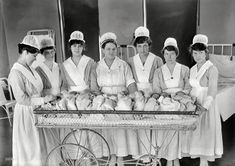 "Washington, D.C., circa 1919. ""Maternity ward. Nurses with babies."" Please have your claim check ready. Harris & Ewing Collection glass negative."
