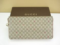 724e613546b Gucci Canvas Clutch Wallets Zip-Around Women s