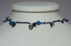 Assorted stones with a blue colour scheme. Sterling silver fittings.  Approximately 16 inches in length, can be extended upon request before sale (after sale requires postage costs)