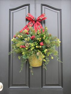Home Decor, Country Christmas Decor, Holiday Wreaths, Christmas Baskets, Wall Pockets, Holiday Decortions  This beautiful container is full of winter forest findings, pine, pinecones, berries and vines... perfect for your front door this holiday season!  **Dont forget, any one of our wreaths would also make a beautiful gift for someone for a birthday, Mothers Day, Easter, Christmas, a house warming gift, baby shower, to cheer someone up...for any reason at all! We would be happy to ship it…