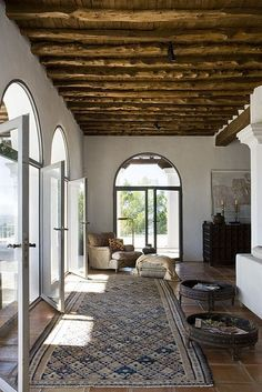 Love the wooden beams and huge windows.