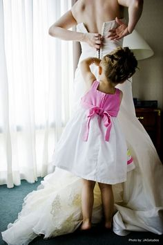 Cuteness alert! Just the littlest member of the wedding party helping the Bride get ready.