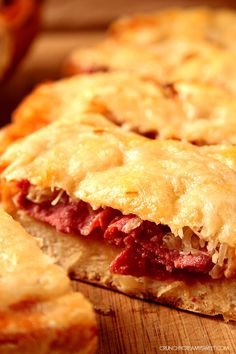 Easy Reuben Cheesy Bread - the classic Reuben sandwich gets a cheesy bread makeover! Toasted Italian loaf topped with Thousand Island dressing, corned beef, sauerkraut and Swiss cheese will turn you into a cheesy bread fanatic!
