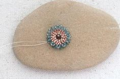 Tutorial to add a ruffled edge to circular brick stitch and give it an organic flower like feel. Make one or a garden full for earrings or clasps or...