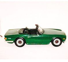 Excited to share the latest addition to my #etsy shop: Triumph TR6 in 1/18 Scale Diecast in British Racing Green http://etsy.me/2hI4A5S #ertl #triumph #tr6 #green #diecast #diecastcar #vintagecar #classiccar #antiquecar #minichamps #kyosho #hotwheels #autoart #vintage #classic #gentleman